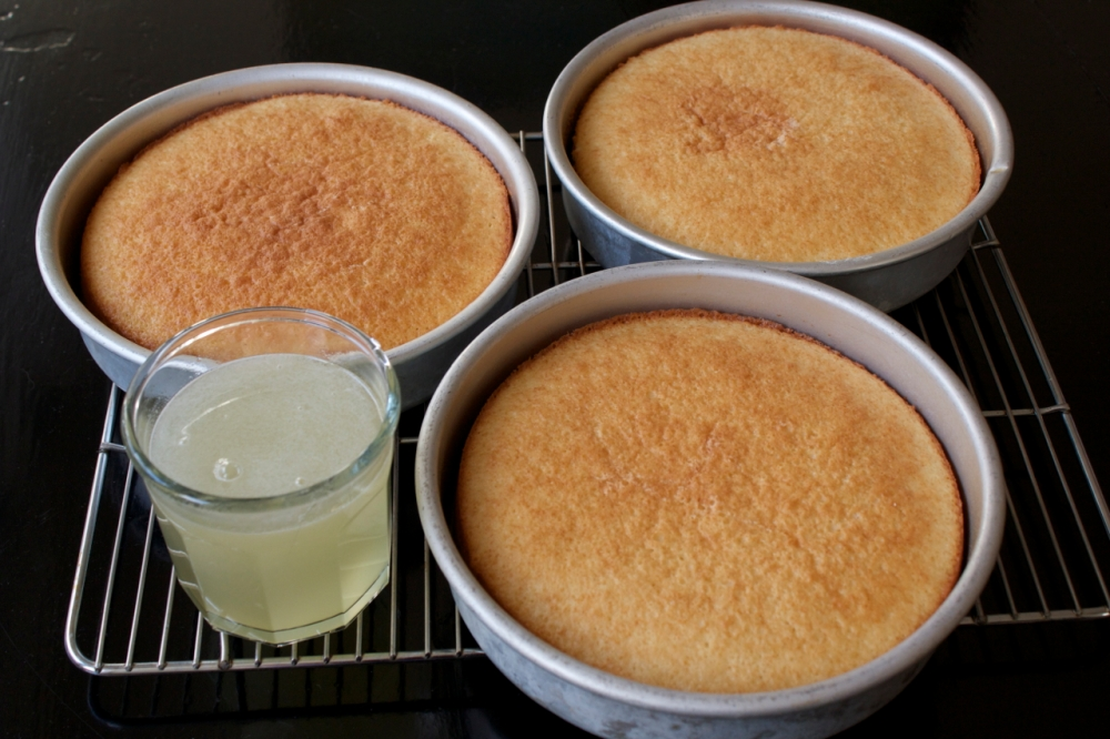 three cake layers and warm lemon syrup