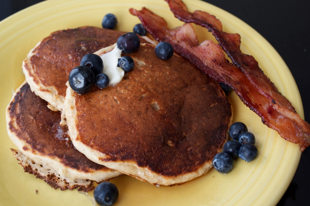 Whole Oat Wheat Pancakes with fresh blueberries and bacon