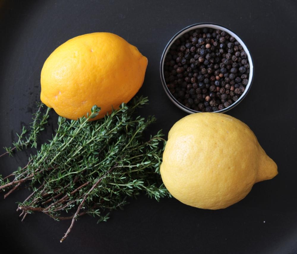 clockwise from top left: Meyer lemon, black pepper, lemon, fresh thyme