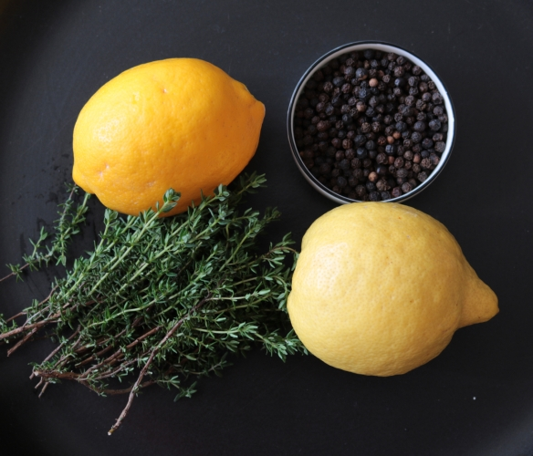 clockwise from top left: Meyer lemon, black pepper, lemon, fresh thyme