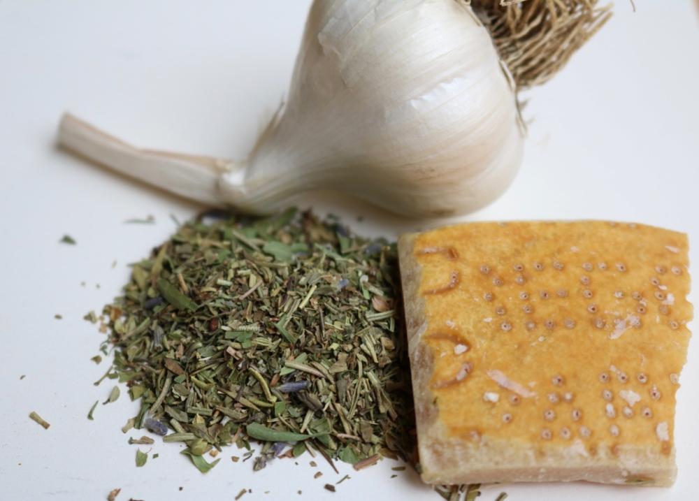 Three key ingredients: fresh garlic, Parmesan cheese rind, and Herbes de Provence